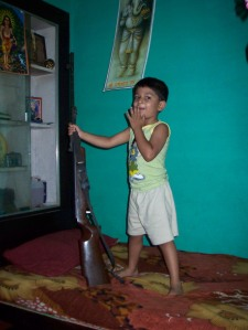 P with the airgun in Arun's house